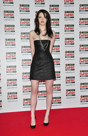 Talulah Riley lengthened her legs with a pair of black leather pumps.