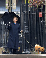 Meryl Streep chose this navy blue trench coat for her rainy-day look in NYC.