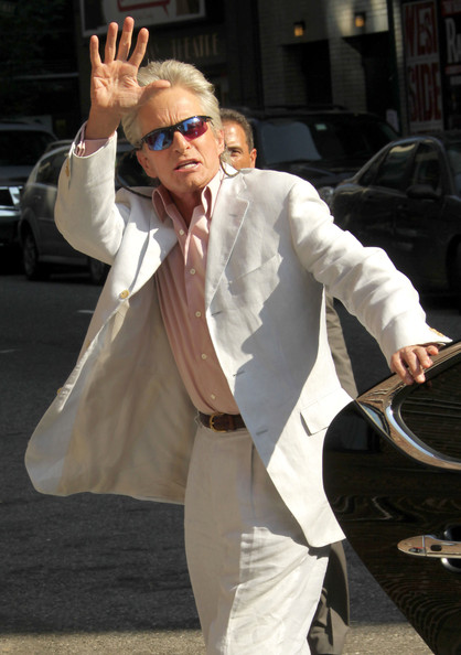 Michael Douglas looks super stylish in this crisp white linen suit and pink button-up shirt.  What do you think of the accompanying glasses?