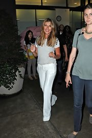 Nina Garcia paired white slacks with an embellished gray top for a casual yet chic look.