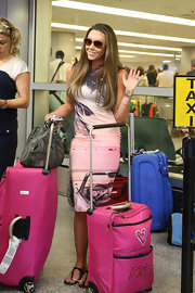 Michelle Heaton arrived at the Miami Airport in a summer-inspired pink dress.