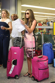 Michelle Heaton matched her pink outfit with pink personalized travel bags.