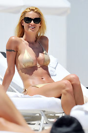 Michelle Hunziker's string bikini was barely noticeable on her super tan body.