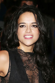 Michelle Rodriguez styled her long hair in messy-glam curls for the Hollywood Costume Ball.