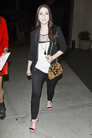 Michelle Trachtenberg kept her look feminine with pink T-strap heels adorned with black bows.