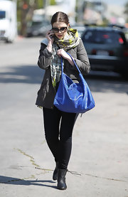 Michelle Trachtenberg added pop to her street style with a cobalt snakeskin bag.