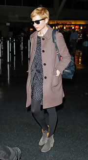 Michelle Williams topped off her winter style with suede ankle boots.