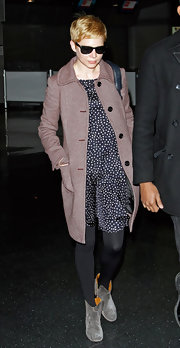 Michelle William's rose tweed coat was a feminine addition to her sweet polka dot dress.