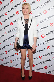 Michelle Williams looked sleek and sophisticated as ever in this white satin blazer, featuring black trim on the lapels.