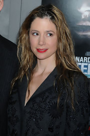 Mira Sorvino sported a just-got-out-of-the-shower look with her tousled 'do.