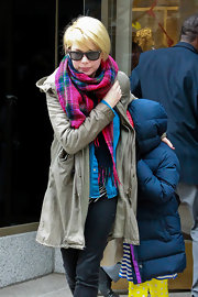 Michelle Williams looked ready for winter with this fluffy, pink plaid scarf.