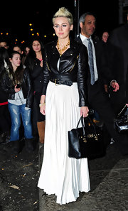 We loved the elegance of this white pleated dress paired with a black leather motorcycle jacket.