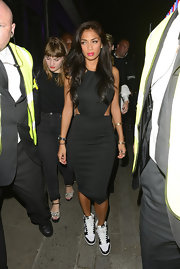 Nicole Scherzinger's simple black dress featured cool side cutouts for a more contemporary touch.