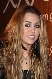 Miley Cyrus accessorized with a gemstone and feather pendant by Daniela Villegas.