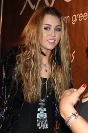 Miley showed off her long highlighted extensions while hitting the grand opening of Xandros restaurant.