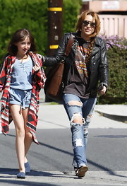 Miley Cyrus was spotted out with sister Noah in a a cool leather jacket with studding at the collar.