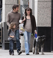 Milla Jovovich stepped out wearing this brown wool coat with her family in Toronto.
