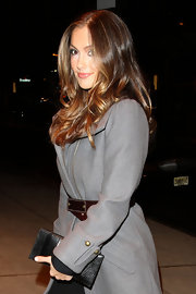 "Minka Kelly travels light, carrying only a slim black snakeskin clutch to ""The Roommate"" after party."
