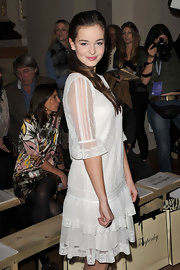 Celine Buckens looked angelic in her little white lace dress during London Fashion Week.