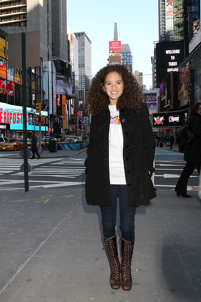 Madison Pettis strolled through Times Square in brown lace up knee high boots.
