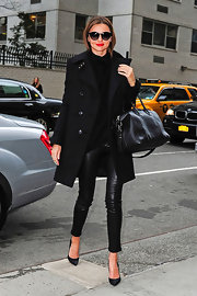 Miranda Kerr looked sharp and sexy in this all-black ensemble featuring a modern wool coat.