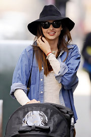 Miranda Kerr wore this floppy hat with her cat eye shades while out walking her baby in NY.
