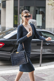 Miranda Kerr wowed on the streets of Paris with this exotic-skin bag and low-cut dress combo.