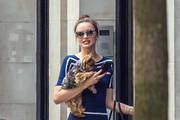 Miranda Kerr seen in a striped navy blue dress taking her dog Frankie for a walk in New York City.