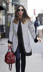 Miranda Kerr gave her street style a graphic touch with a black-and-white print jacket.