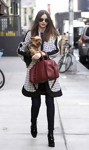 Miranda Kerr topped off her chic style with black lace-up boots.