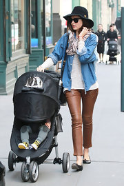 Miranda Kerr embraced the leather trend in NYC wearing cropped cognac pants.