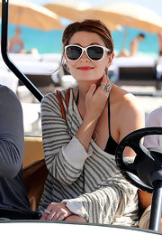Mischa Barton enjoyed her vacation in white retro cateyes.