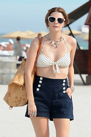 Mischa Barton maintained the nautical vibe of her beachwear with a tan map print tote.