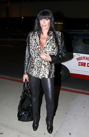 Angela Raiola left little to the imagination in a pair of skintight leather leggings.
