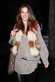 Alessandra wears a dyed fur scarf with a casual chic ensemble.