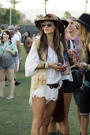 Alessandra Ambrosio chose a white prairie-style top for her bohemian look at Coachella.