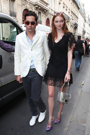 Lily Cole's gray snakeskin purse added a futuristic feel to her feminine ensemble at the Dior fashion show.