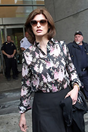 Linda Evangelista left court in this sophisticated floral blouse.