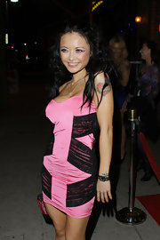 Tila showed off her figure in a hot pink cocktail dress while leaving a comedy club in Hollywood.