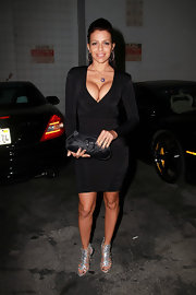 Former video vixen Vida Guerra looked ready to party for her birthday in this hip-hugging black ensemble. She topped her look off with a sleek Dior clutch.