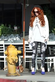 Phoebe Price was styling, even while walking her dog, when she wore splatter-print skinny pants.