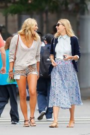 Ashley Hart opted for a pair of gladiator sandals while out strolling with her sis Jessica.