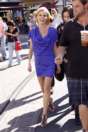 Julie Bowen was ultra chic in purple at the set of 'Extra' in LA. The TV starlet paired her draped mini dress with brown strappy sandals complete with tassel detailing.