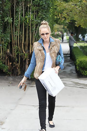Monet Mazur donned a classic denim jacket under a brown fur vest while running errands in LA.