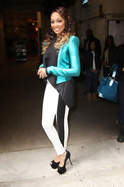 Monica met with fans and signed autographs in NYC while wearing a dramatic pair of black peep toe platform pumps.