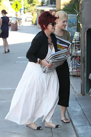Sharon Osbourne was wearing a white maxi, a black cardigan and a pair of bow-detailed ballet flats as she stocked up on books and magazines at BookSoup.
