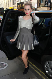 Diane showed off her signature edgy side while hitting the streets of London in a leather clad grey dress.