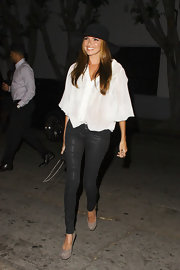 Nadine Coyle attended Perez Hilton's birthday party in a chic loose blouse.