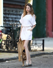 A loose t-shirt dress cinched at the waist gave Behati Prinsloo a casual but still flirty look on the set of a Victoria's Secret shoot.