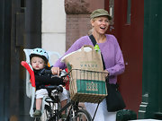 Naomi Watts wore an army green military cap while out for a ride with her family.